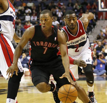 Kyle Lowry gets by John Wall en route to a 24-point, 10-assist night for the division-leading Raptors.  (USATSI)