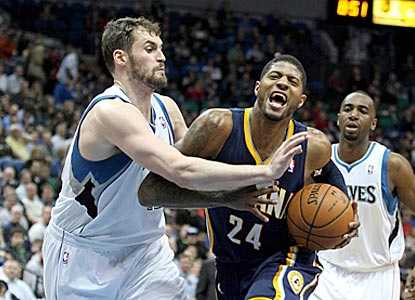 Kevin Love (42 points) gets the better of Paul George (35) in the box score, which helps the Wolves knock off the Pacers.  (USATSI)