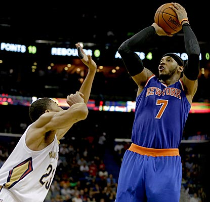 Carmelo Anthony shoots over Anthony Davis during the final quarter, in which he scores 13 points and leads New York to victory. (USATSI)
