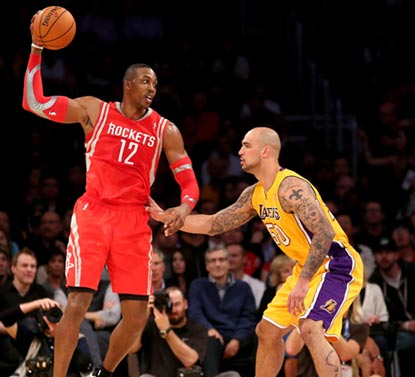 Dwight Howard and the Rockets toy with Robert Sacre and the Lakers for most of the noncompetitive evening.  (Getty Images)