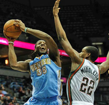 Kenneth Faried is on a roll, scoring 26 points to help push the Nuggets past the lowly Bucks.  (USATSI)