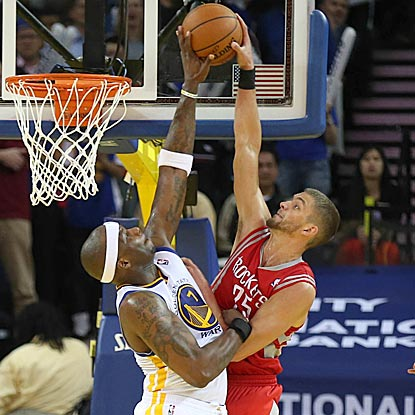 Golden State's Jermaine O'Neal elevates and rejects Chandler Parsons' dunk attempt during overtime. (USATSI)