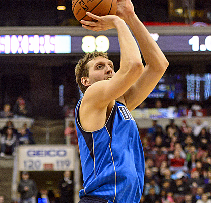 Dirk Nowitzki combines with Shawn Marion for 47 points as the Mavs send the Sixers to a 10th straight defeat.  (USATSI)
