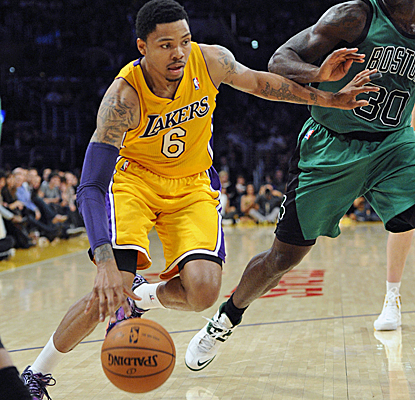 Recently acquired Kent Bazemore scores 13 points in his Lakers debut, helping LA to rally past the Celtics.  (USATSI)