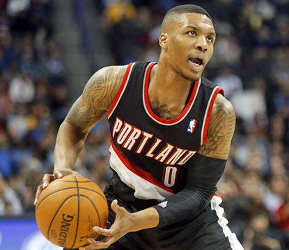 The Blazers, playing without their All-Star center, lean on Damian Lillard, who comes up big down the stretch against Denver. (USATSI)