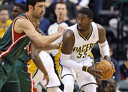 Roy Hibbert posts 24 points and 12 rebounds, helping the Pacers to fend off the Bucks' second-half surge.  (USATSI)