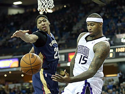 DeMarcus Cousins (right) tallies 23 points and 12 rebounds and wins his matchup with Anthony Davis (13 points, four rebounds).  (USATSI)