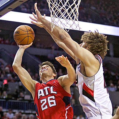 Kyle Korver has a tough night shooting 2-pointers, too. He misses 3 of 4, including this try against Portland's Robin Lopez.  (USATSI)