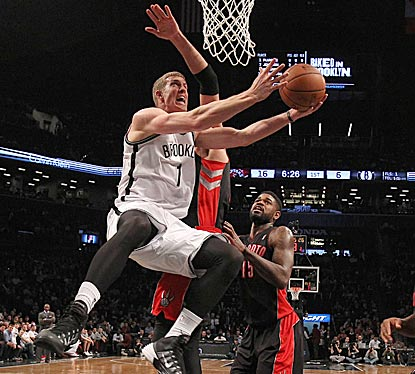 Starting in place of Kevin Garnett, rookie Mason Plumlee contributes six points and a team-high eight rebounds.  (USATSI)