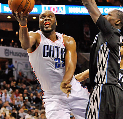 Al Jefferson posts 25 points and 16 boards and the Bobcats have won eight straight at home.  (USATSI)