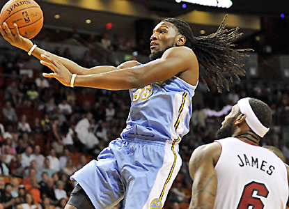 Kenneth Faried scores 24 points, and Denver's bench plays big in sending the sliding Heat to another loss.  (USATSI)