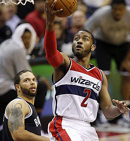 John Wall takes matters into his own hands, scoring 33 points as the Wizards push into the No. 5 seed.  (USATSI)