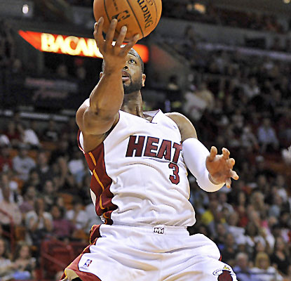 Dwyane Wade matches LeBron James with 24 points, and the Heat halt their worst stretch of games since 2011.  (USATSI)