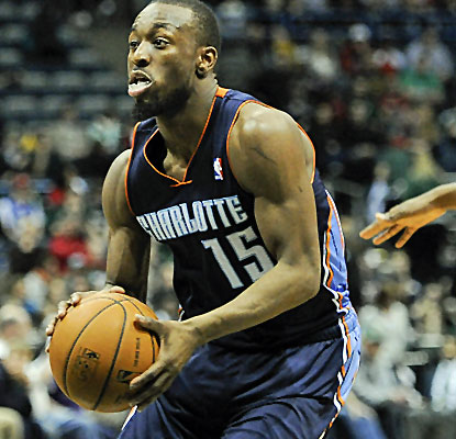Kemba Walker scores 21 points, and the suddenly streaking Bobcats have their sights on the No. 5 seed.  (USATSI)