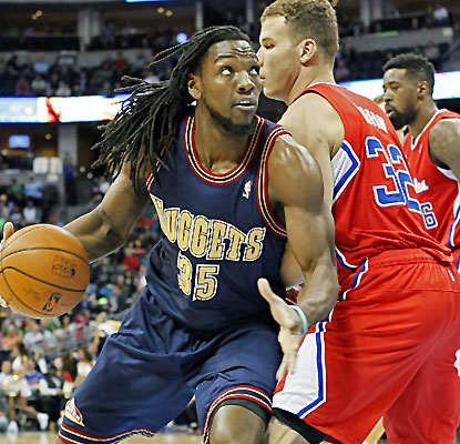 Kenneth Faried racks up 18 points and 16 boards as the Nuggets bring an end to the Clips' 11-game win streak.  (USATSI)