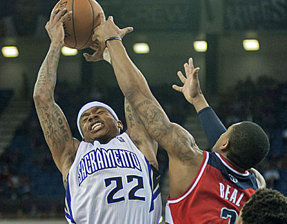 Isaiah Thomas fights for a rebound in earning his first triple-double in Sacramento's win over the Wizards. (USATSI)