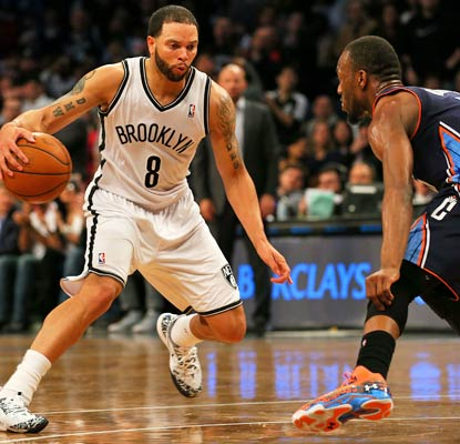Deron Williams takes control down the stretch, scoring 11 of his 23 points in the last six minutes for the Nets.  (USATSI)