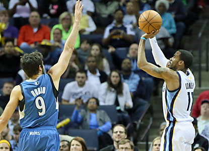 Grizzlies guard Mike Conley chips in with 23 points, including this corner 3 over Ricky Rubio. (USATSI)
