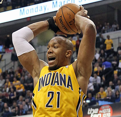 David West and the Pacers muscle their way past the Heat to extend their East lead to three games. (USATSI)