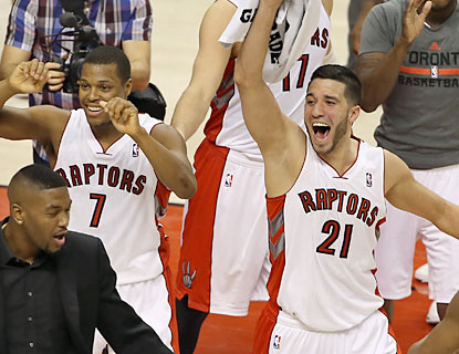 The Raptors celebrate their first playoff berth in six seasons, thanks to their go-ahead basket with seven seconds left. (USATSI)