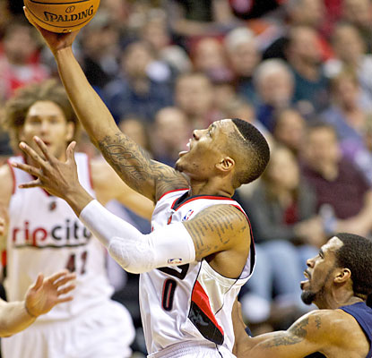 Damian Lillard, one of five Blazers to reach double figures, helps them to their third straight win. (USATSI)