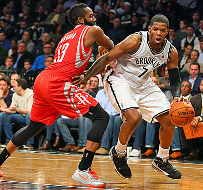 Joe Johnson (right) scores 32 points in the Nets' playoff-clinching win over the Rockets in Brooklyn. (USATSI)