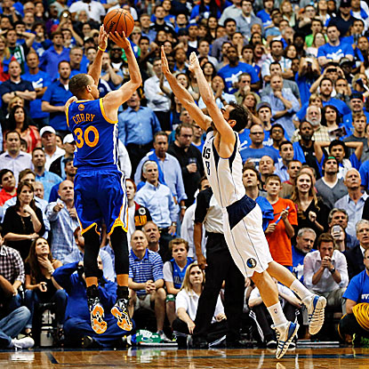 Stephen Curry hits the winning shot over the outstretched arms of the Mavs' Jose Calderon in the final seconds of overtime. (USATSI)