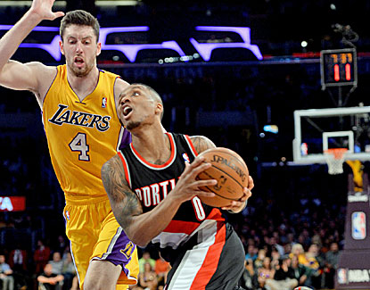 Portland's Damian Lillard lights up the Lakers for 34 as LA falls within one defeat of its first 50-loss season since 1974-75. (USATSI)