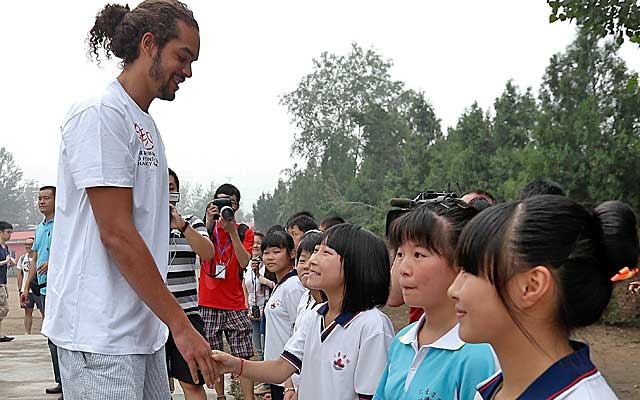 Noah greets children at a school during a trip to China in the offseason.    (Getty Images)