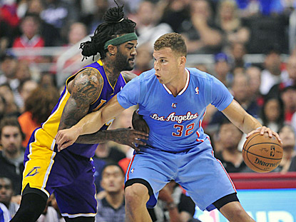 Blake Griffin, shown working against Jordan Hill during the first half, helps the Clippers domnate the Lakers again.  (USATSI)