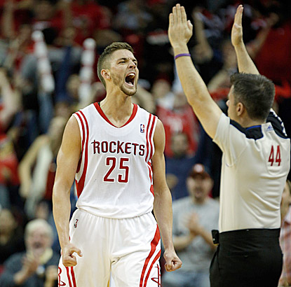 Houston's Chandler Parsons exults after connecting on a 3-point shot in the overtime period.  (USATSI)