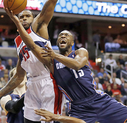 Kemba Walker and the Bobcats win their fifth straight and move past the Wizards for sixth place in the East. (USATSI)