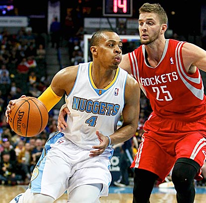 Chandler Parsons (right) and the Rockets can't contain Nuggets point guard Randy Foye in the second half.  (USATSI)