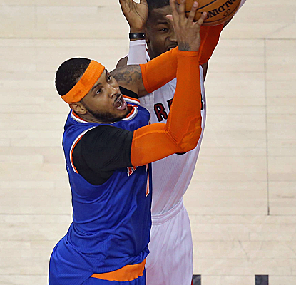 Carmelo Anthony is doing everything he can to get the Knicks into the playoffs, scoring 30 points in Toronto.  (USATSI)