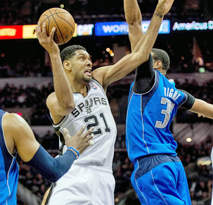 Tim Duncan (game-high 27 points) helps the Spurs pull away late in the fourth to thwart the Mavs' attempt to steal Game 1. (USATSI)