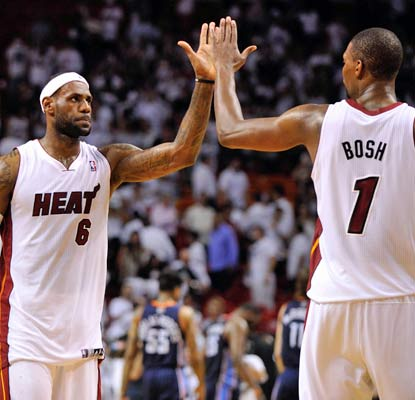 LeBron James and Chris Bosh combine for 52 points to make sure the Heat head to Charlotte up 2-0 in the series.  (USATSI)