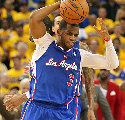 Chris Paul is fired up after denying Stephen Curry on the final possession as the Clippers edge the Warriors.  (USATSI)