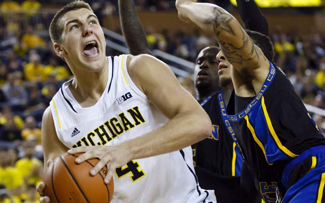 Michigan's Mitch McGary is going to the NBA rather than serve his suspension. (USATSI)