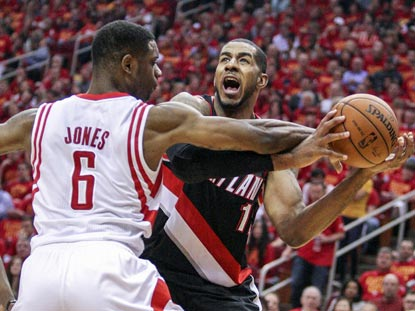 Houston's Terrence Jones (left) helps limit LaMarcus Aldridge to eight points on 3-of-12 shooting.  (USATSI)