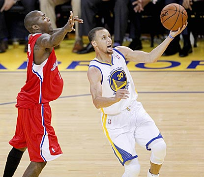 Stephen Curry sails past Jamal Crawford for a layup attempt in the third quarter. Curry scores 24 points on 9-of-24 shooting.  (USATSI)