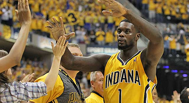 Lance Stephenson celebrates advancing past the Hawks with Pacers fans Saturday. (USATSI)