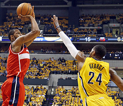 Trevor Ariza (22) drains all six of his attempts from beyond the arc to help the Wizards steal Game 1 in Indiana. (USATSI)
