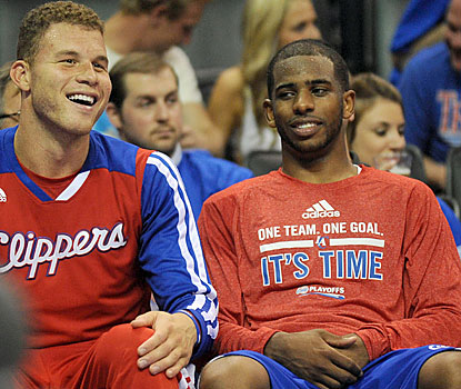 Blake Griffin (23 points) and Chris Paul (32 points) get some much-earned rest in the fourth after helping rout OKC in Game 1. (USATSI)