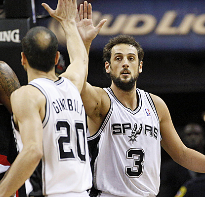 Marco Belinelli and Manu Ginobili combine for 29 points off the bench as the Spurs hold serve at home.  (USATSI)