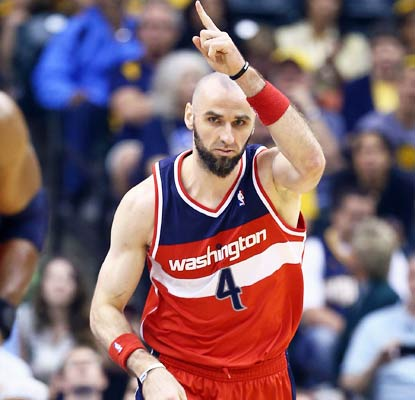 Marcin Gortat has a huge night for Washington with 31 points and 16 rebounds to lead the blowout win.  (Getty Images)