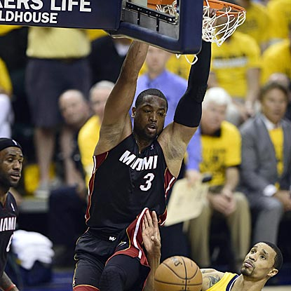 Dwyane Wade dunks home a LeBron James miss to help Miami pull away from Indiana in the fourth quarter.  (USATSI)