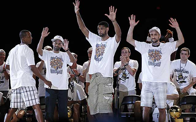 The Spurs' Big Three, Tony Parker, Tim Duncan and Manu Ginobili acknowledge the crowd at the Alamodome.  (Getty Images)