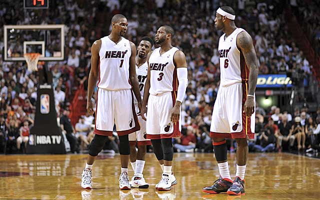 Dwyane Wade (3) must figure out his role alongside Chris Bosh (1), minus LeBron James. (USATSI)