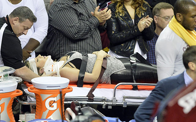 Jason Day's wife leaves the arena via stretcher after getting run over by LeBron. (USATSI)