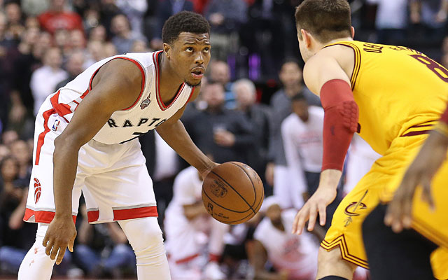 Kyle Lowry breaks down Cleveland's Matthew Dellavedova before hitting the winner. (Getty Images)